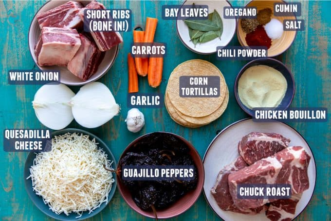 Ingredients laid out that are needed to make homemade birria and quesatacos at home.