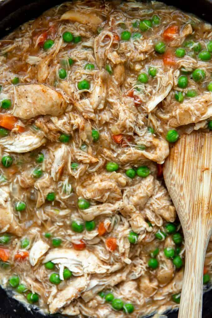 Up close view of pot pie filling with shredded chicken.