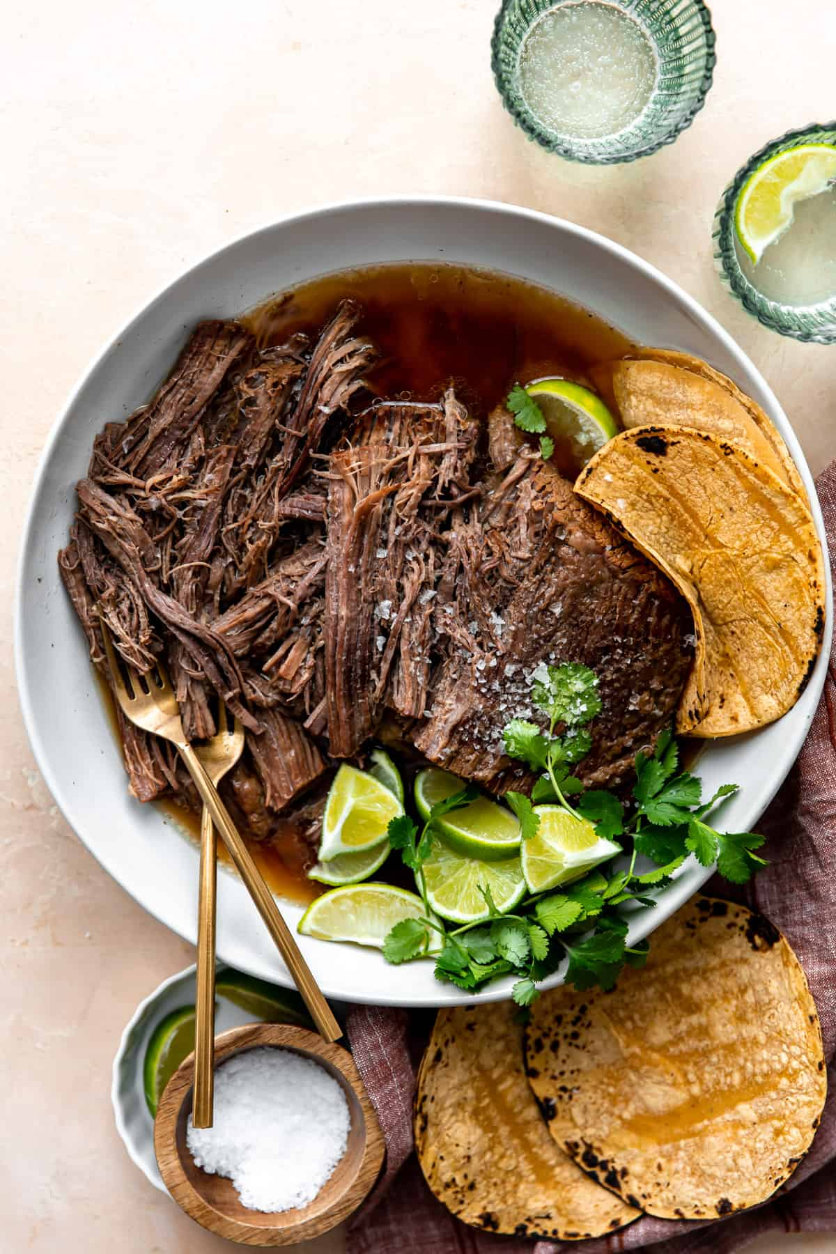 Bowl of shredded Mexican brisket for tacos.