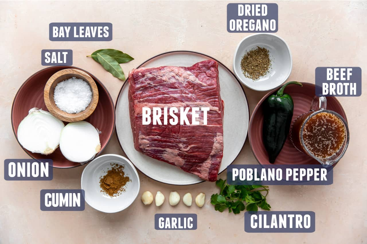 Ingredients needed for making brisket tacos laid out on counter.
