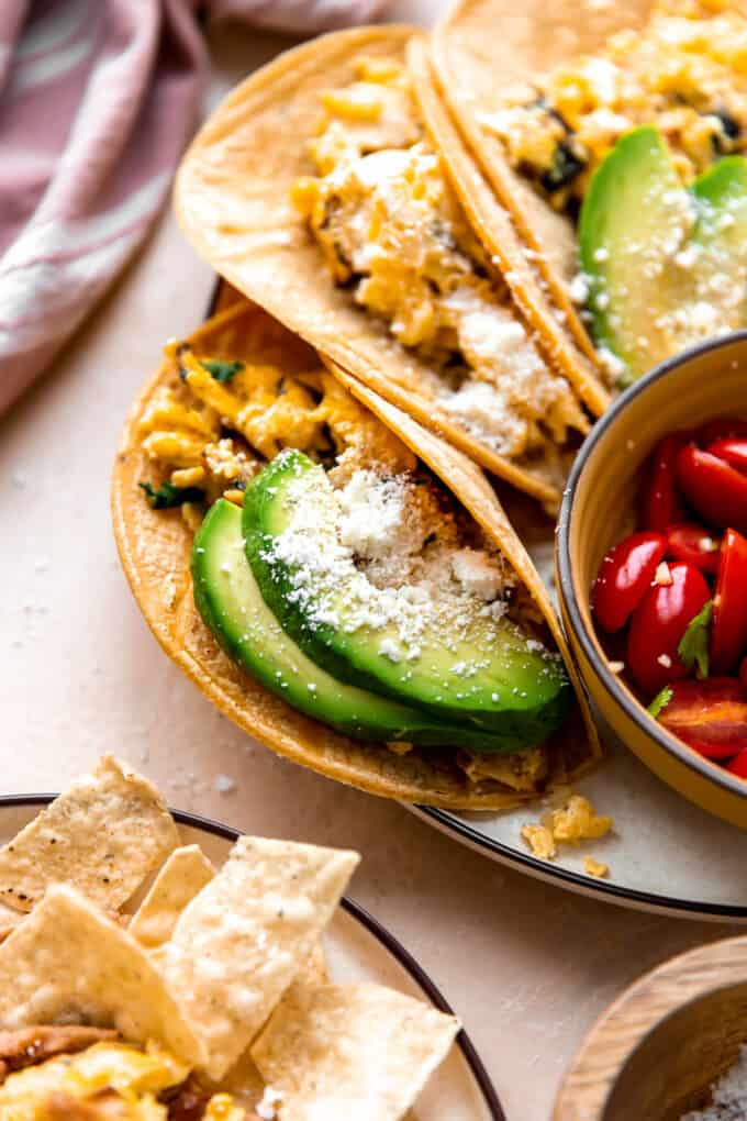 Migas served in corn tortillas with avocado and crumbled queso fresco.