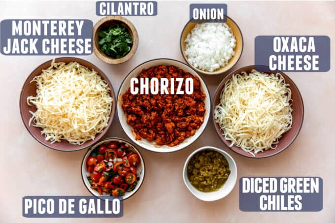 Ingredients needed for queso fundido laid out on a counter.