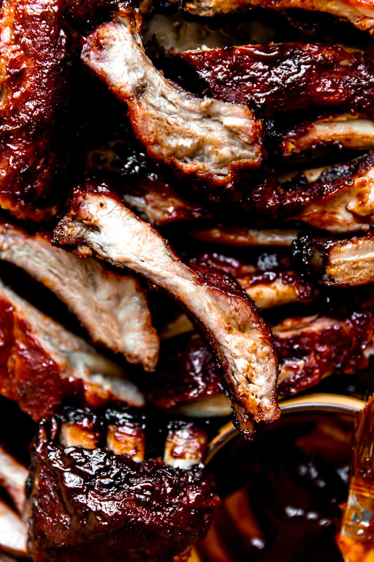 Sliced pork ribs that have been smoked all stacked and ready to serve.