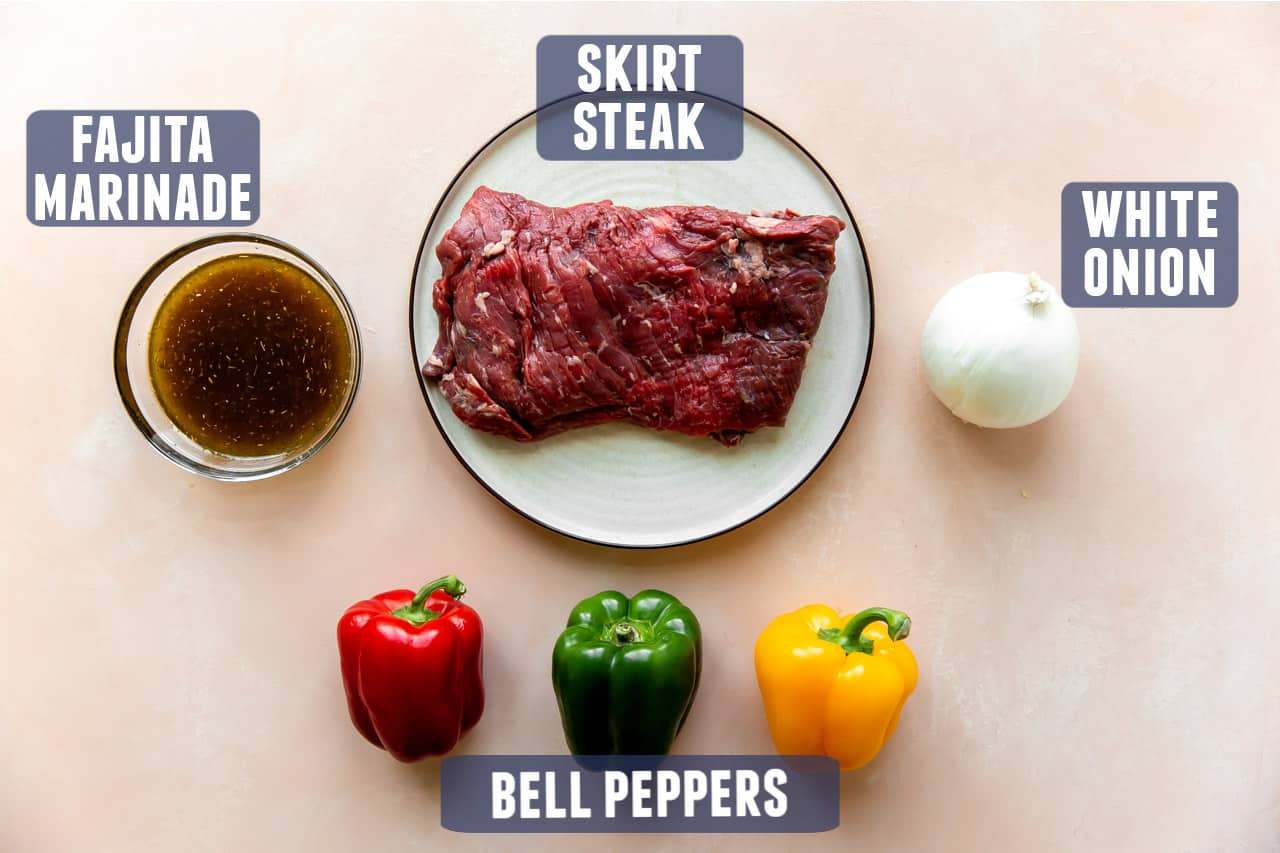 Ingredients for steak fajitas laid out on a counter.