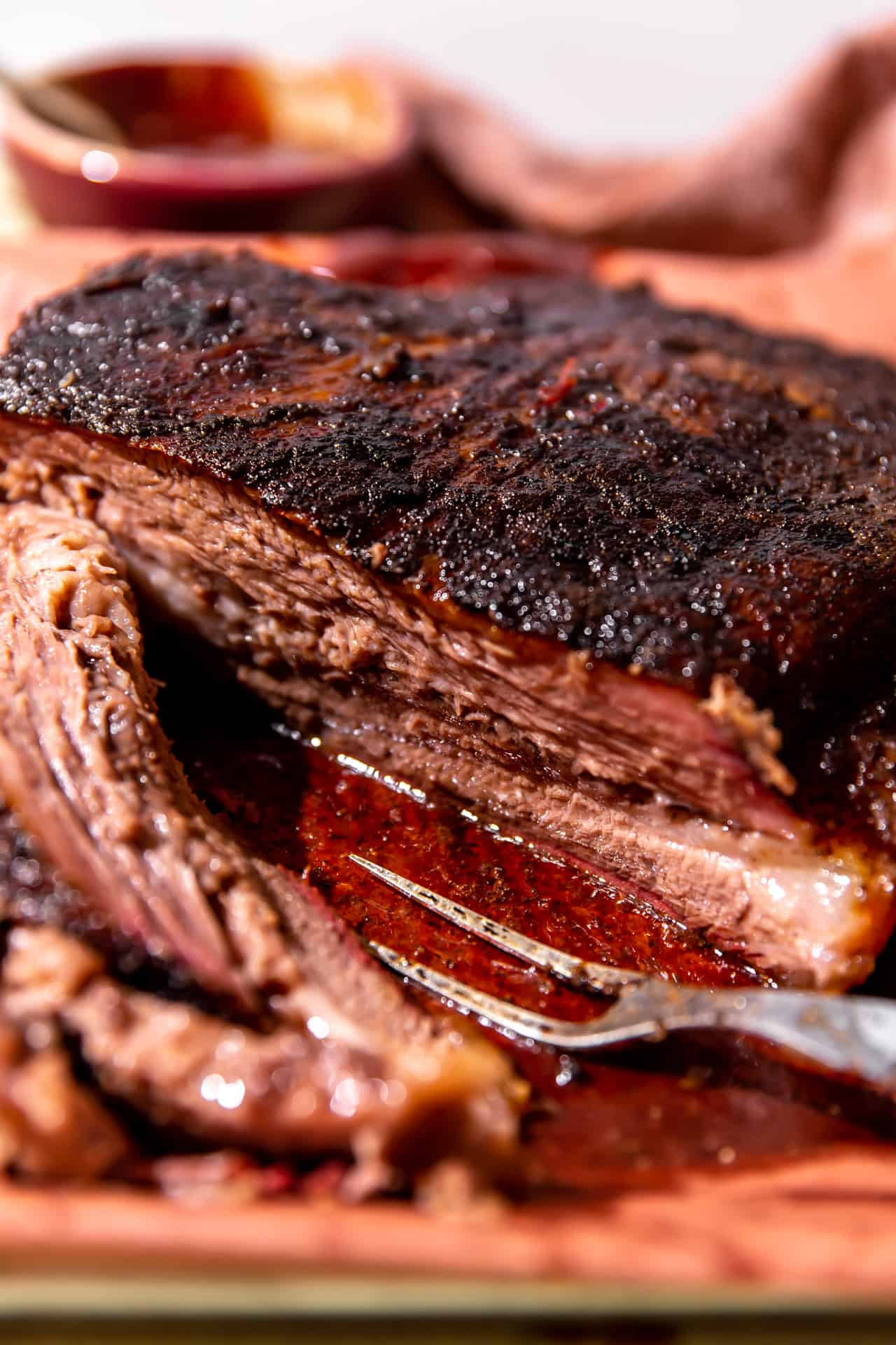 Sliced beef brisket after smoking with juices coming out.