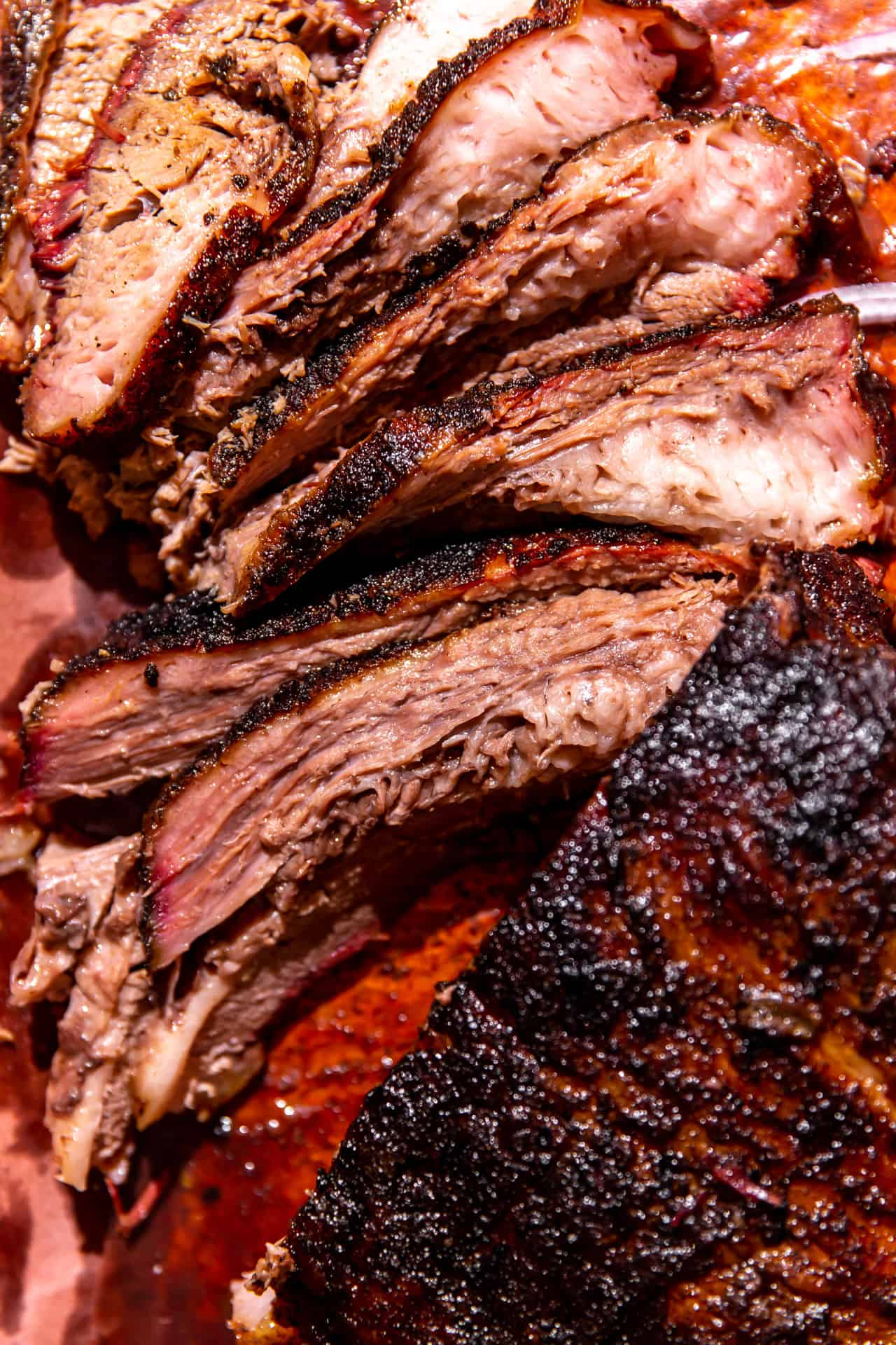 Sliced Texas Smoked Brisket on peach paper.