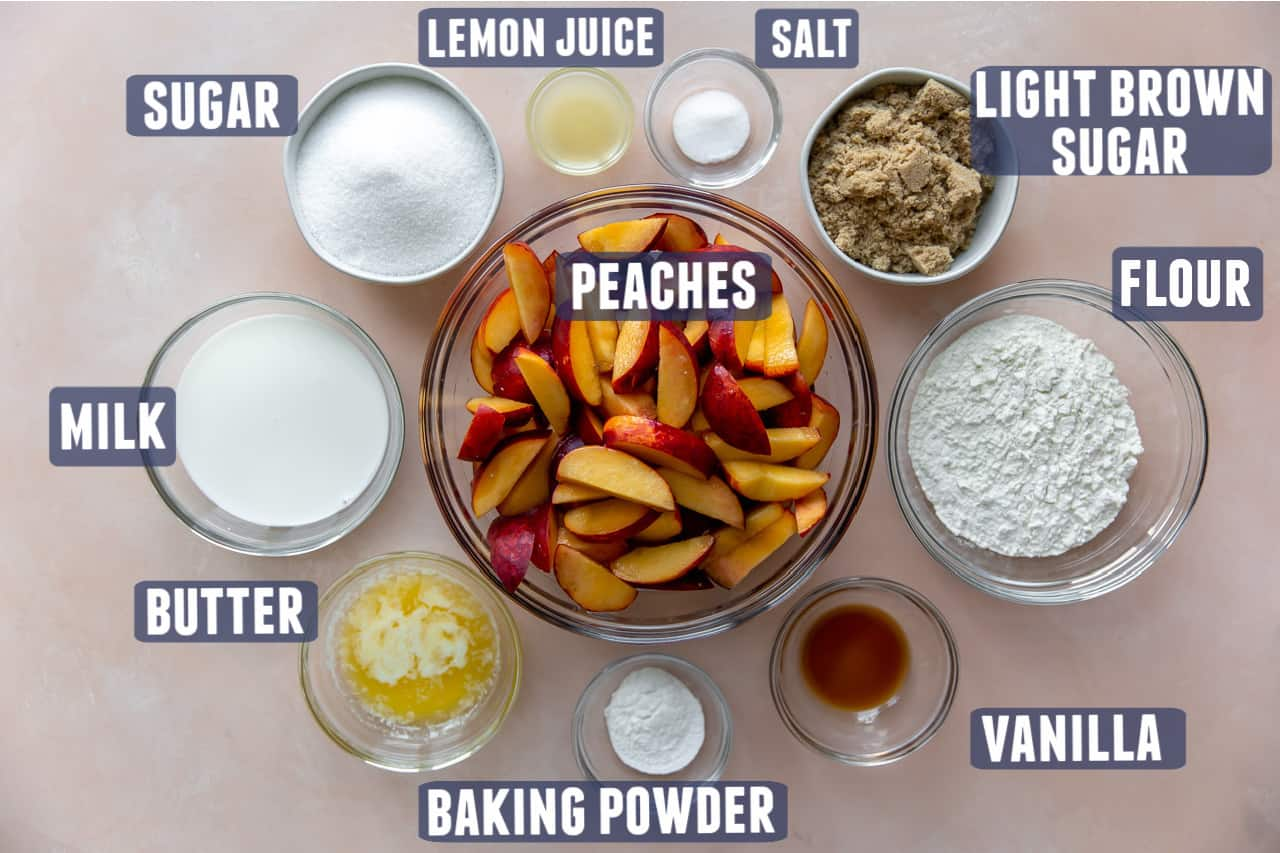Ingredients needed for peach cobbler laid on the counter.