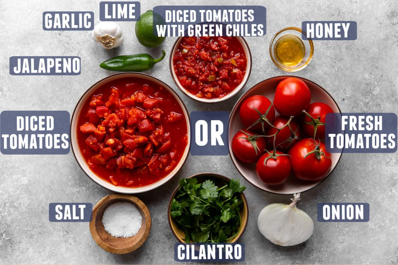Ingredients needed to make salsa laid out on the counter.