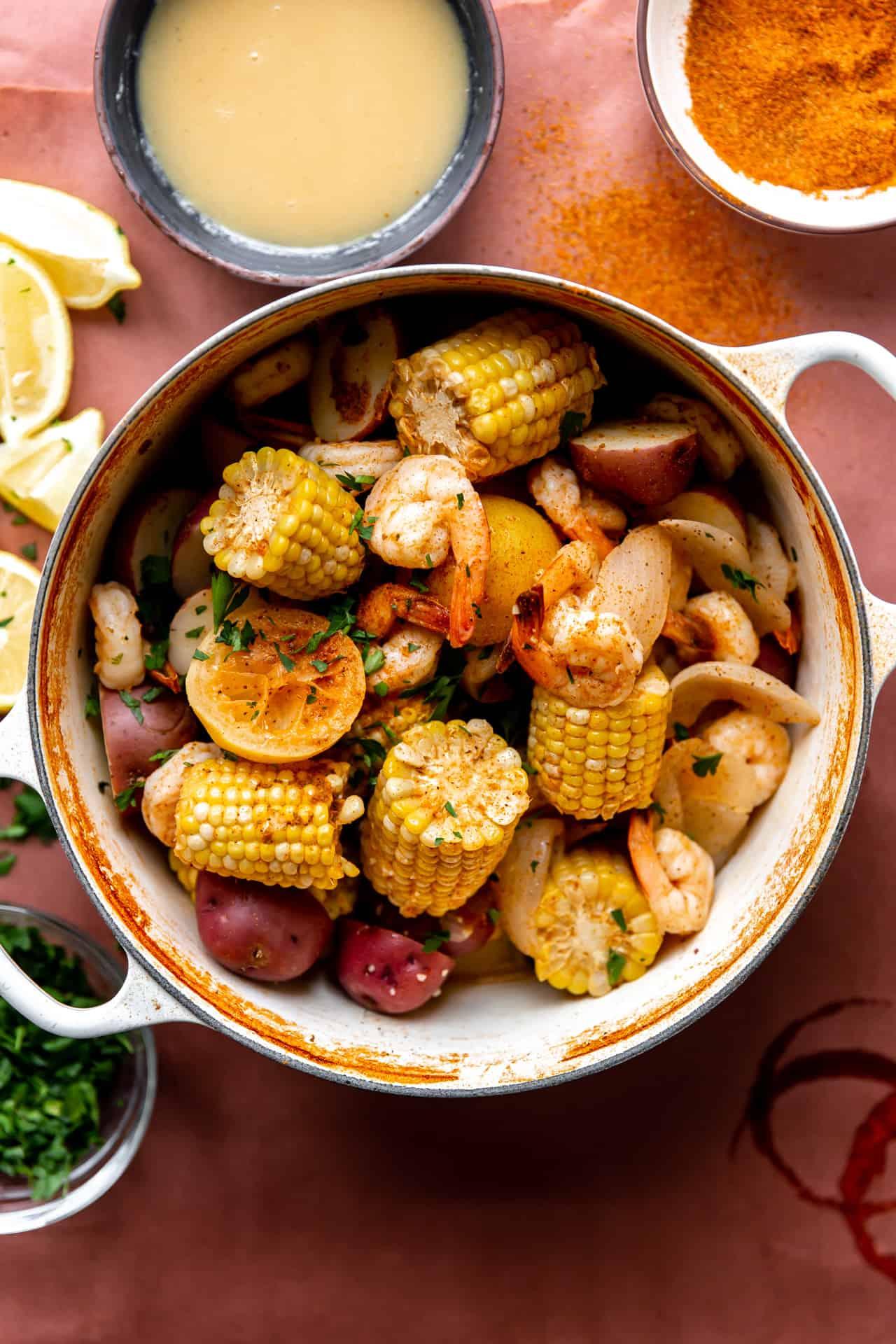 Large pot filled with cooked shrimp boil.