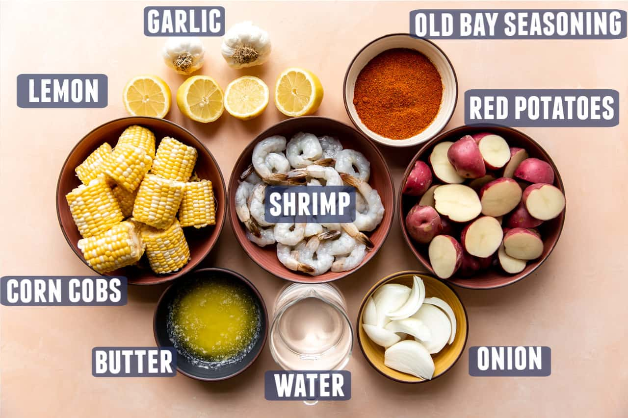 Ingredients needed to make a shrimp boil laid out on the counter.