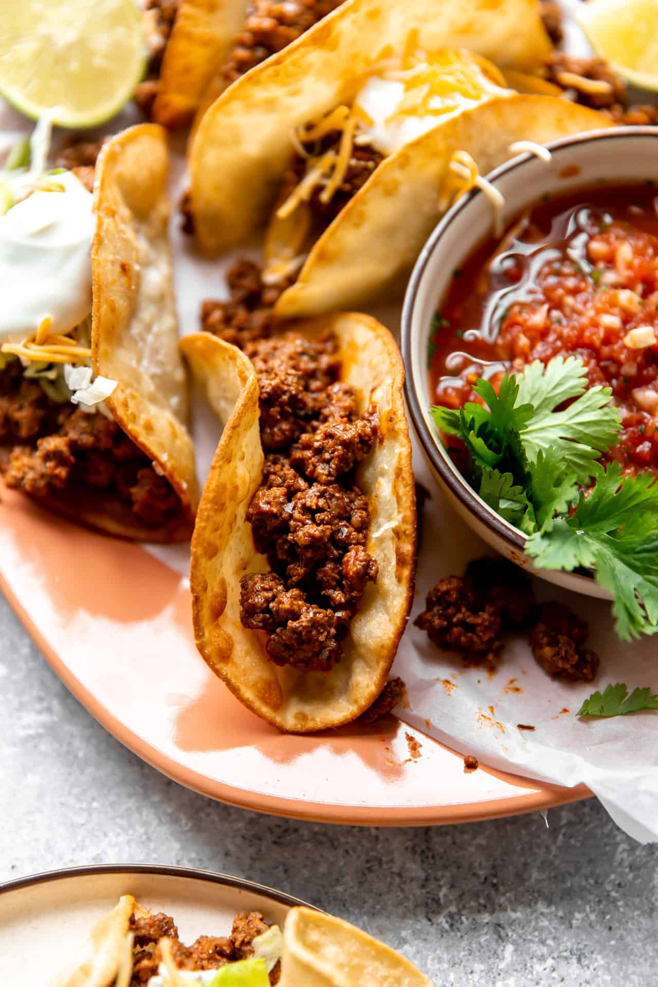 Best ever ground beef taco meat loaded into fried corn tortillas.