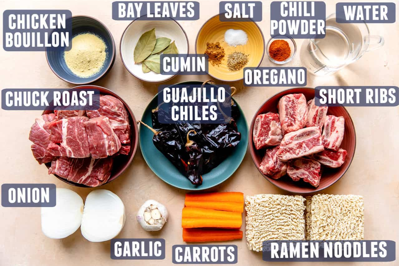 Ingredients needed to make homemade birria laid out on a counter.