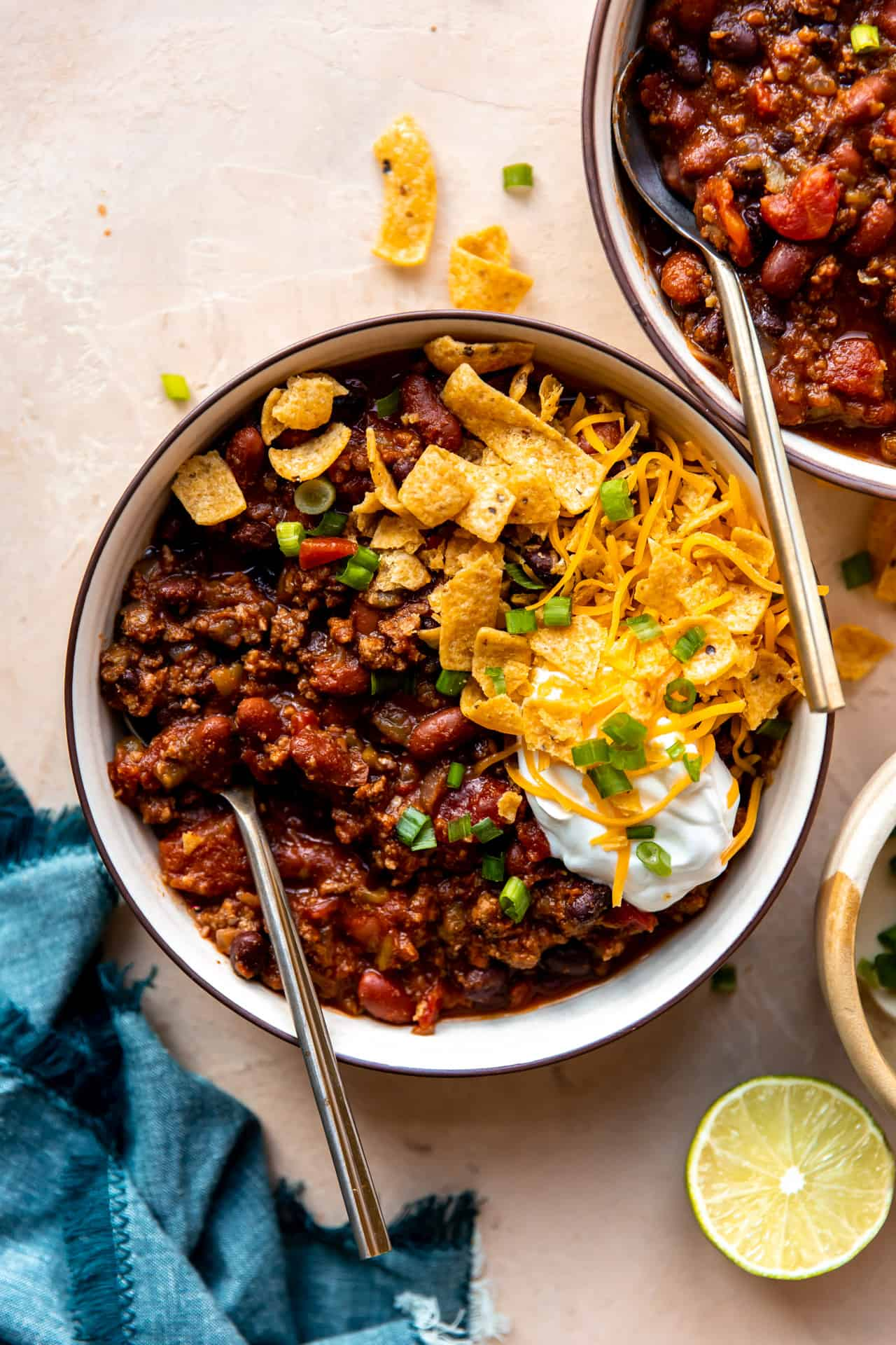 Overhead view of a bowl of chili with toppings.